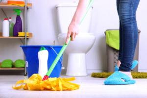 Cleaning floor in bathroom